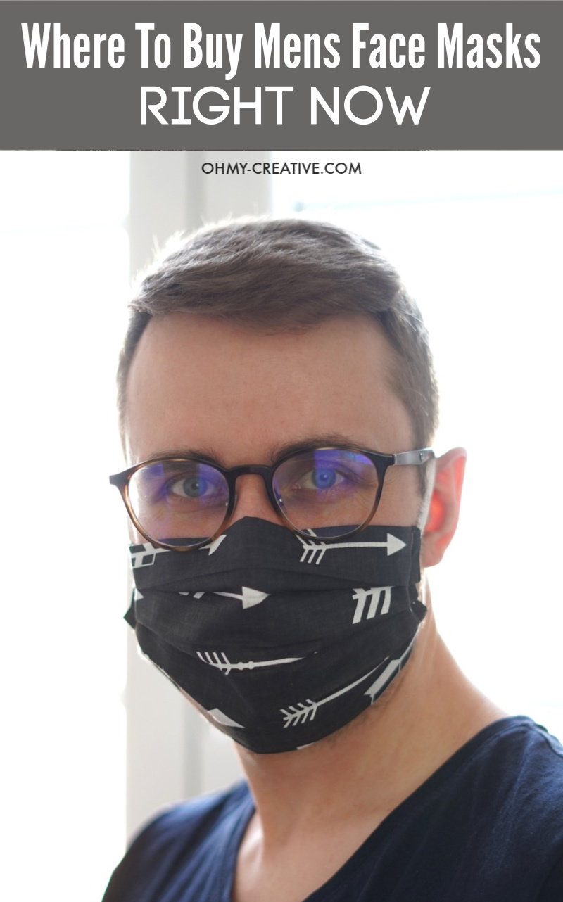 Man wearing a fitted black face mask.