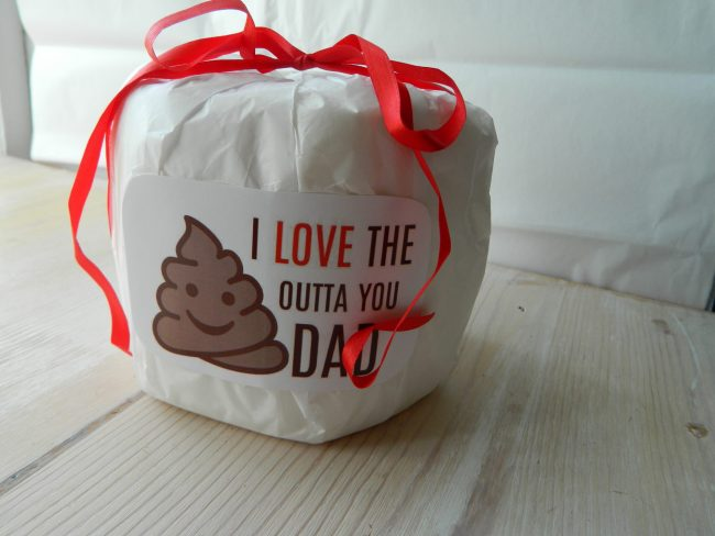 Toilet paper toll wrapped with tissue paper and printed sticker on the outside