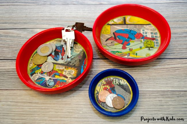 Round clay dishes painted with comic images on the inside bottom