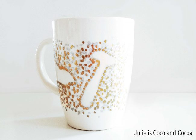 white mug with glitter and outlined shapes of hammer and more