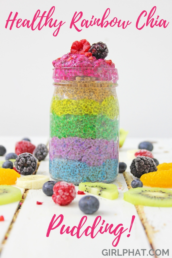 Rainbow chia pudding surround by fruit