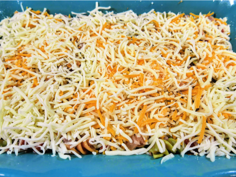 After ingredients are mixed together top with cheese before baking.