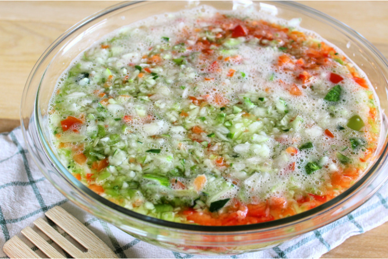Cover chopped vegetables with water in a bowl and chill.