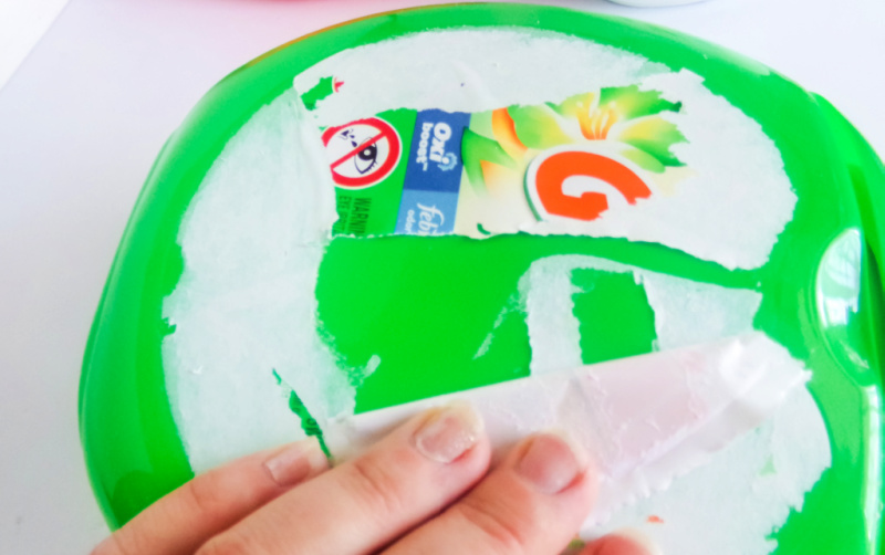 How to remove a paper laundry container label for crafting.