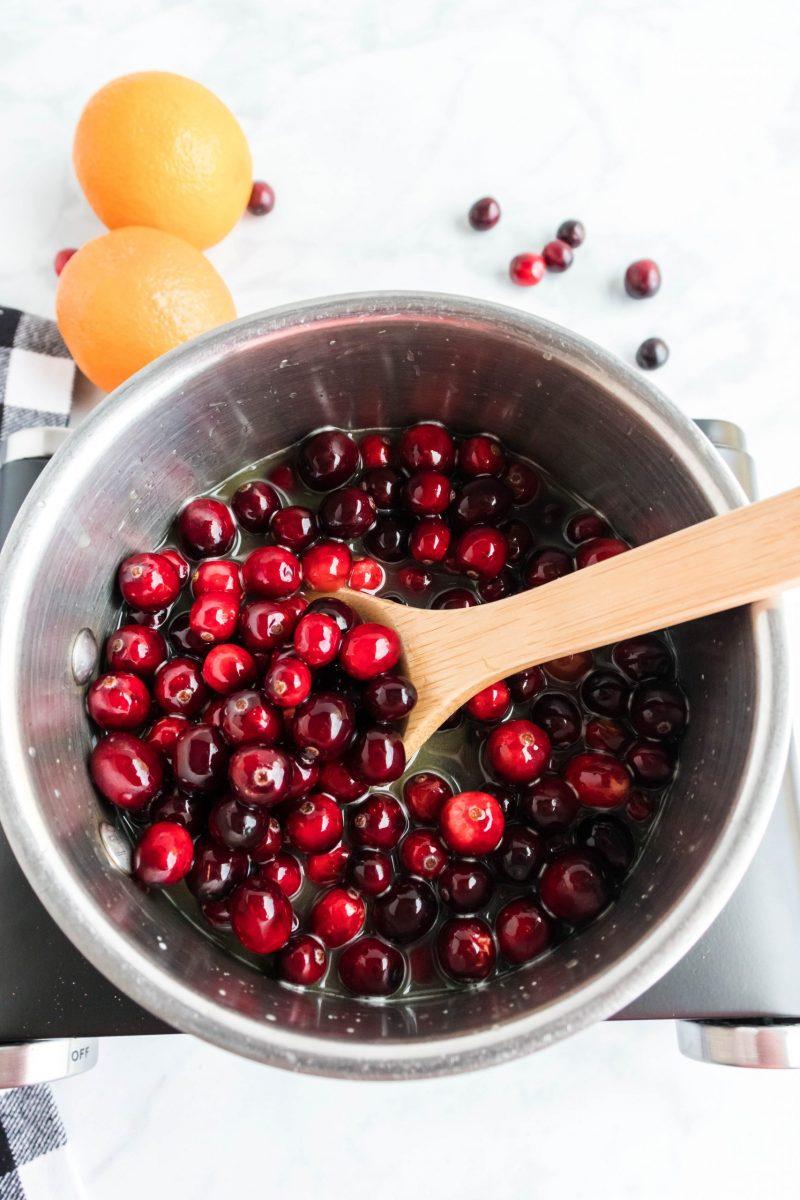 Keep stirring cranberries until they split.