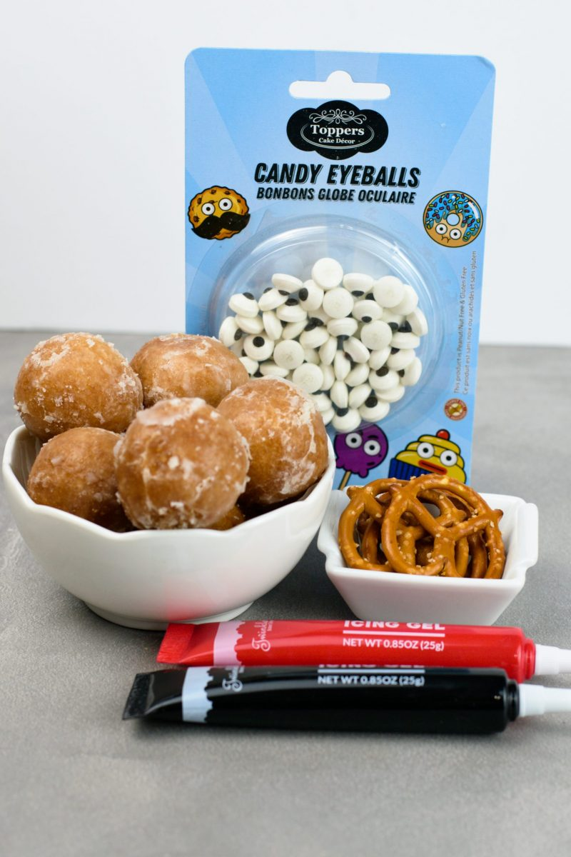 Ingredients and supplies to make reindeer donuts.