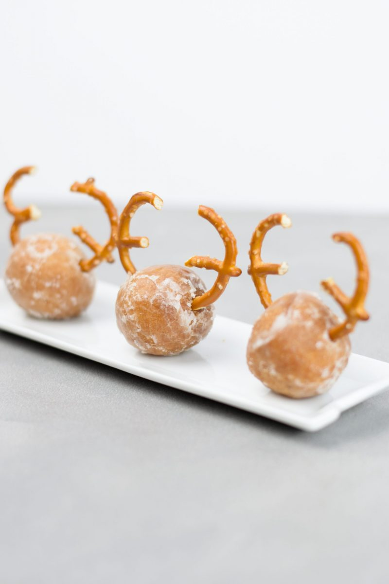Glazed donut holes with pretzels for antlers