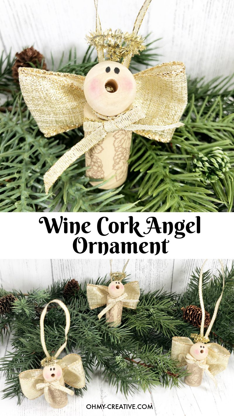 A finished wine cork angel displayed on some evergreen garland.