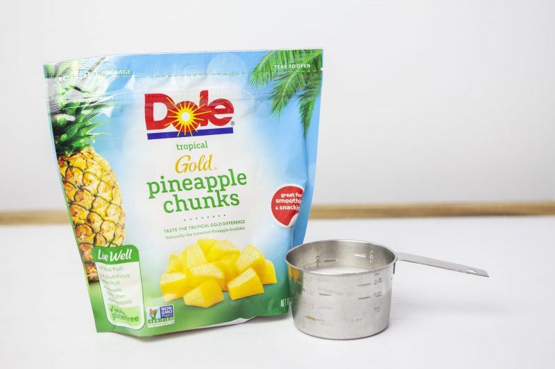 Healthy Dole whip ingredients: one bag of frozen pineapple and a cup of almond milk.