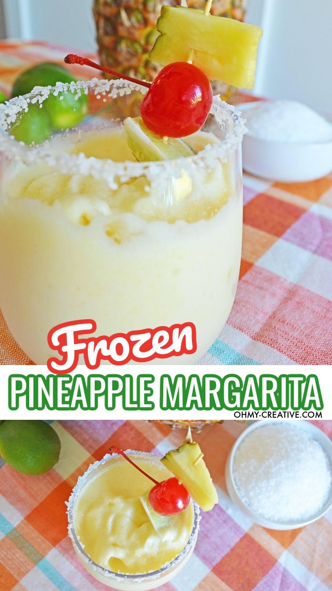 A pineapple margarita in a round bottom stemless glass with a salt rim. This cocktail is garnished with a slice of lime, a cherry and a cube of fresh pineapple. The margarita sits on a orange plaid napkin with fresh limes and a pineapple in the background.