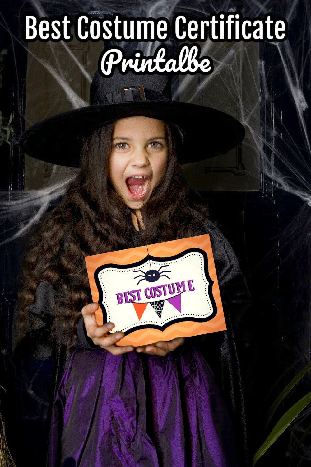 Young girl dressed as a witch holding a Best Costume certificate at a Halloween party.!