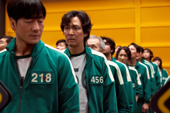 Squid Game Contestant Costume with contestants dressed in green tracksuits.