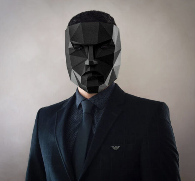 Front Man from Squid Game with black geometric mask and black suit.